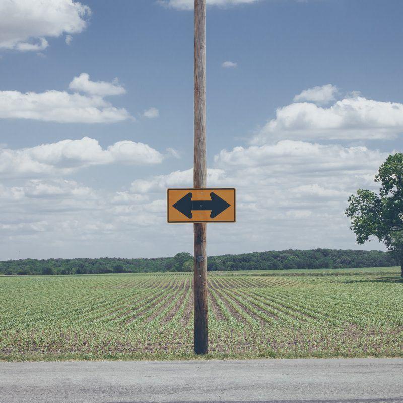 Arrows field sign post