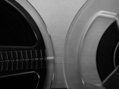 Two film and sound reels in black and white.
